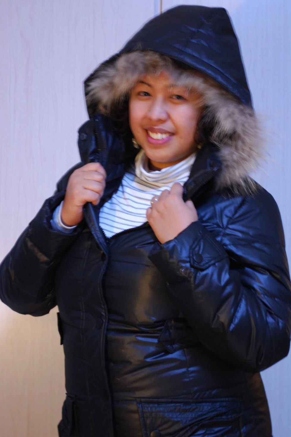 black bubble jacket with rabbit fur on the hood